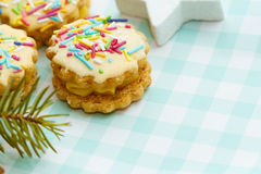 Christmas sweets on checkered tablecloth Royalty Free Stock Images