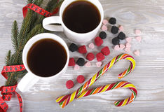 Christmas sweets and coffee. Christmas coffee, sugar cane, spruce twig on a gray background Stock Photography