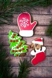 Christmas sweets, colorful gingerbreads, cookies in the form of. A decorated Christmas tree, dogs and mittens, stylized with snowflakes and New Year`s mood Royalty Free Stock Photography
