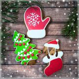 Christmas sweets, colorful gingerbreads, cookies in the form of. A decorated Christmas tree, dogs and mittens, stylized with snowflakes and New Year`s mood Royalty Free Stock Photo