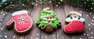 Christmas sweets, colorful gingerbreads, cookies in the form of. A decorated Christmas tree, dogs and mittens, stylized with snowflakes and New Year`s mood Stock Image