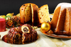 Christmas sweets on decorated table royalty free stock images