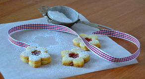 Christmas sweets. Flowers with sour cherry jam stock photos