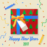 Christmassweets andgifts. Christmassweets andgiftshangingon a rope 2017 with background Stock Image