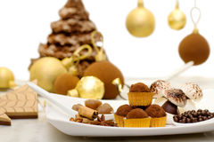 Christmas sweets, meringue and chocolate bauble with christmas c Royalty Free Stock Image