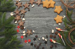 Christmas sweets and pine tree branches background, mockup Stock Photo