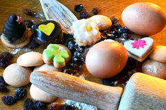 Christmas sweets, raisins, eggs and flour Royalty Free Stock Photos