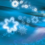Christmas swirl. Christmas texture in blue with snowflakes Stock Photos