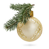 Christmas Symbol. Golden Christmas Ball with Fir Twigs Royalty Free Stock Images