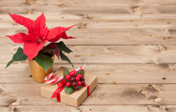 Christmas Symbol. Poinsettia Flower. Gift Box. Christmas Symbol Poinsettia Flower. Gift Box. Decorations. Wooden Background Stock Photography