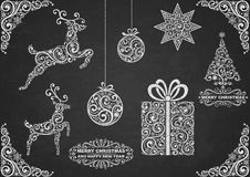 Christmas symbols chalkboard. Set of christmas symbols, hand grawn with chalk on a chalkboard Royalty Free Stock Images