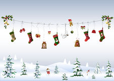 Christmas symbols on a clothes lines. Clothes line with Christmas symbols and a snowy landscape Royalty Free Stock Photos