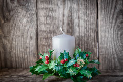 Christmas symbols including Candle. On a wooden table Royalty Free Stock Photography