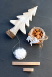 Christmas. Symbols including  tree, almonds and the toy Stock Photography