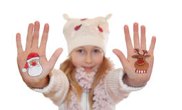 Christmas symbols painted on hands. Christmas background Stock Photos