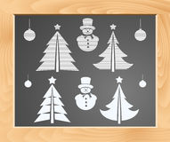 Christmas symbols set on a school blackboard Royalty Free Stock Photos
