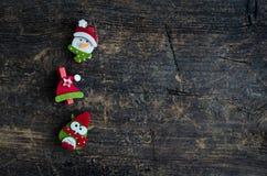 Christmas symbols on wooden background Stock Photos