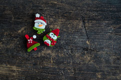 Christmas symbols on wooden background Royalty Free Stock Images