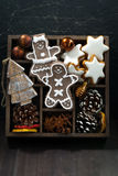 Christmas symbols in a wooden box on dark wooden background Royalty Free Stock Images