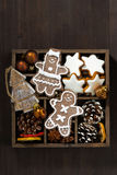 Christmas symbols in a wooden box on dark wooden table, vertical Royalty Free Stock Images