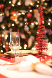 Christmas table. Set christmas dinner table, decorated christmas tree in background, selective focus Stock Images