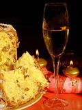 Christmas table. A glass of dessert wine, panettone cake and a Christmas wreath with candles Stock Photo