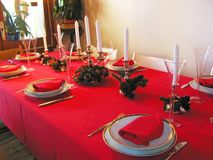 Christmas table. In red with typical decoration Royalty Free Stock Photo