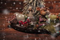 Christmas table arrangement on wooden background Royalty Free Stock Photo