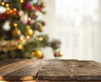 Christmas table background with christmas tree out of focus Royalty Free Stock Images