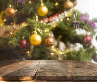 Christmas table background with christmas tree out of focus Royalty Free Stock Image