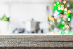 Christmas table background with christmas tree in kitchen out of focus. Background for display your products. stock photos