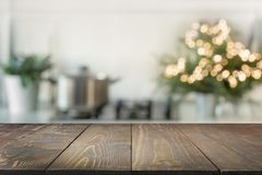 Christmas table background with christmas tree in kitchen out of focus. Background for display your products royalty free stock images
