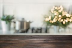 Christmas table background with christmas tree in kitchen out of focus. Background for display your products. Christmas table background with christmas tree in royalty free stock photography