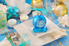 Christmas table with blue bauble decoration Royalty Free Stock Photography