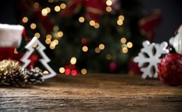 Christmas Table Blurred Lights Background, Wood Desk in Focus, Xmas Wooden Plank, Blur Home Room. Christmas Table Blurred Lights Background, Wood Desk in Focus royalty free stock photo