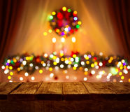 Christmas Table Blurred Lights, Wood Desk Focus, Wooden Plank. Christmas Table Blurred Lights Background, Wood Desk in Focus, Xmas Wooden Plank, Blur Home Room Stock Photo