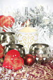 Christmas table with candle. Christmas table decoration with hearts Royalty Free Stock Photos