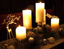 Christmas table with candles and reindeer Royalty Free Stock Photography