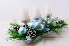 Christmas table centerpiece with candles and blue ornaments Stock Photos