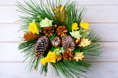 Christmas table centerpiece or door wreath with golden cones Royalty Free Stock Photo