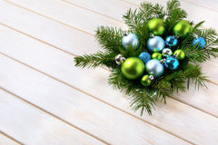 Christmas table centerpiece with light blue and green ornaments Royalty Free Stock Photo