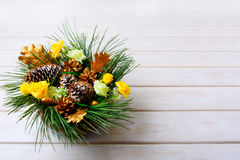 Christmas table centerpiece with pine branches and golden fir co Royalty Free Stock Photography
