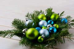 Christmas table centerpiece with silver, blue and green ornament Royalty Free Stock Images