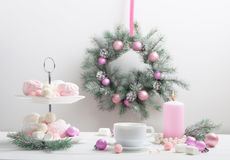 Christmas table with cup of coffee. And dessert Royalty Free Stock Image