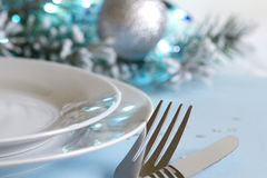 Christmas table with cutlery and tableware Royalty Free Stock Images
