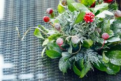 Christmas table decor background with red berries and snow. Horizontal Stock Images