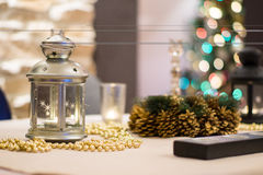 Christmas Table. Decorated Christmas table at home with lantern and beads stock image
