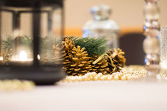 Christmas Table. Decorated Christmas table at home with lantern and beads royalty free stock image