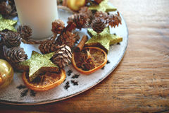Christmas table decoration with candle and spices Stock Photography