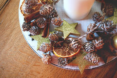 Christmas table decoration with candle and spices Royalty Free Stock Photo